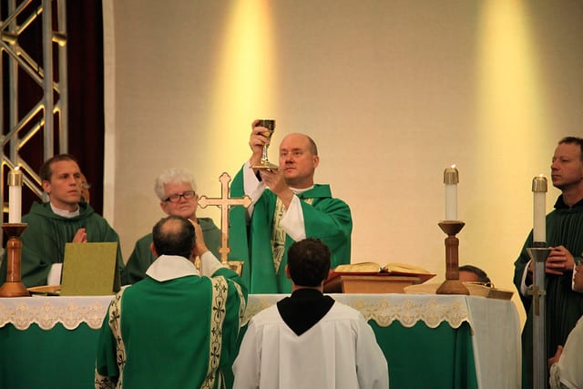 Father Dave saying Mass at a Conference