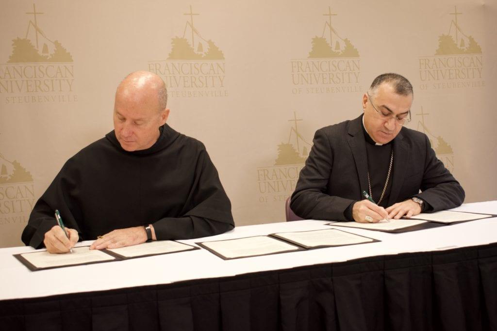 Fr. Dave Pivonka & Archbishop Bashar Warda signing