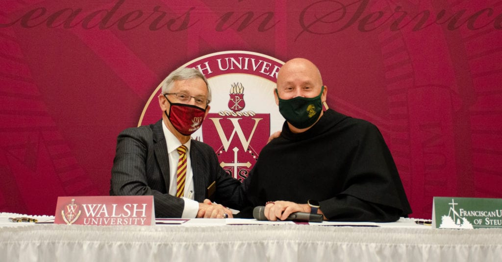 Dr. Timothy J. Collins, president of Walsh University, and Father Dave Pivonka, TOR, president of Franciscan University of Steubenville, signed memorandums of understanding at a special ceremony at Walsh University.