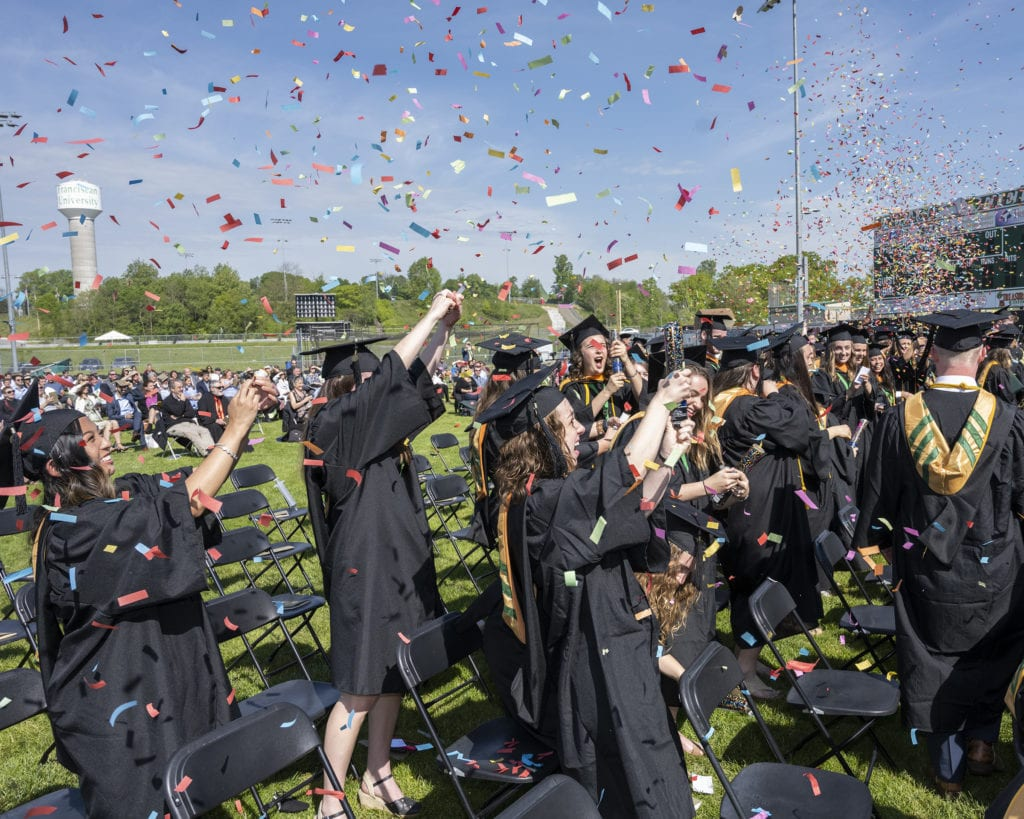 Graduates of Franciscan University's Bachelor of Science in Nursing Program celebrate being called to the stage to receive their diplomas.