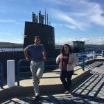 2 Students in front of a submarine