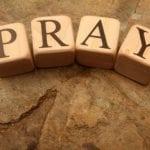 Pray on wooden blocks