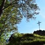 Metal Cross on Mountain in Europe