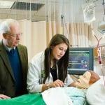 Professor Antinone assisting a nursing student with a nursing dummy