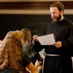 Friar teaching class